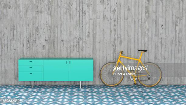 modern sideboard, bike leaning against concrete wall