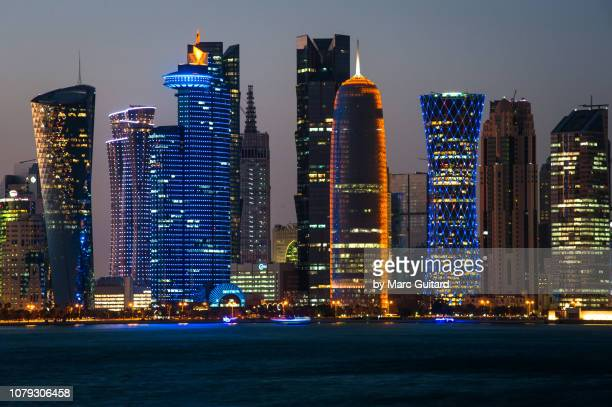 modern skyline of doha, qatar - doha stock pictures, royalty-free photos & images