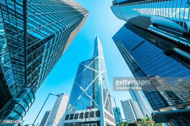 modern skyline with business skyscrapers - hong kong stock pictures, royalty-free photos & images