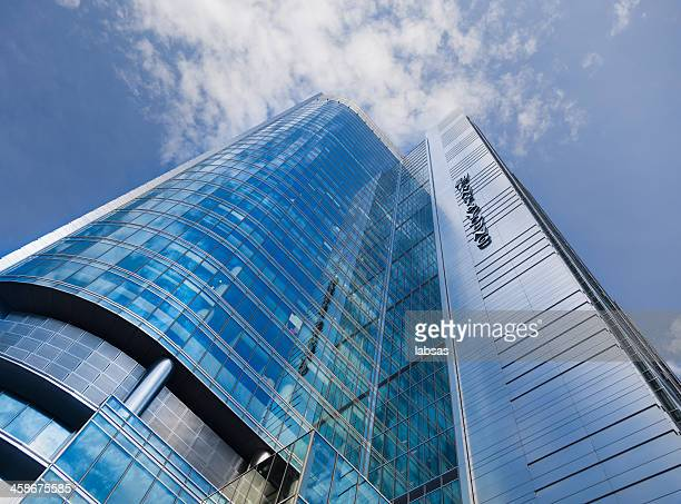 modern skyscraber with blue sky and reflections. - ernst & young stock photos and pictures