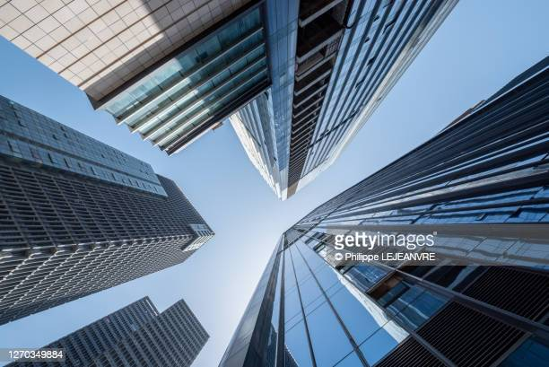 modern skyscrapers against blue sky low angle view - skyscraper stock pictures, royalty-free photos & images