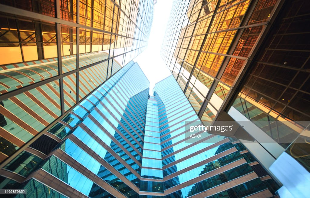 Modern skyscrapers in business district : Stock Photo