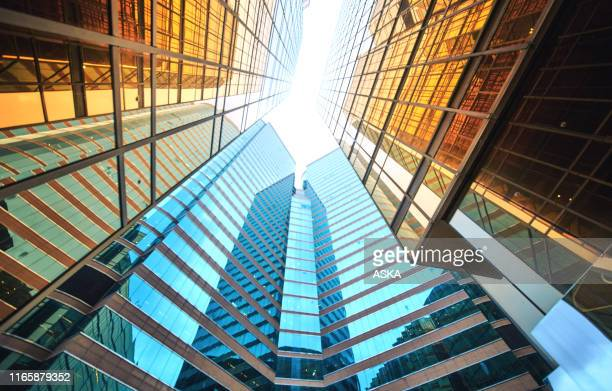 modern skyscrapers in business district - skyscraper imagens e fotografias de stock