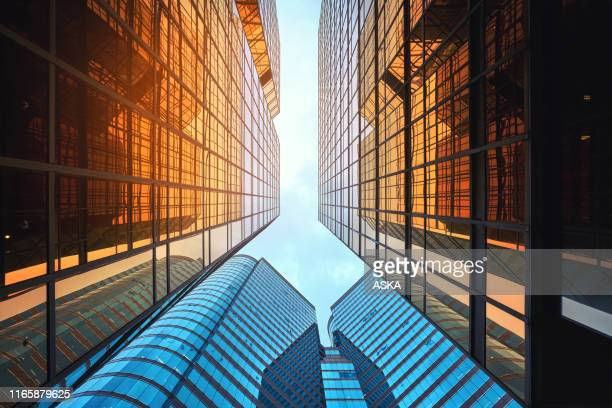 modern skyscrapers in business district - office block exterior stock pictures, royalty-free photos & images