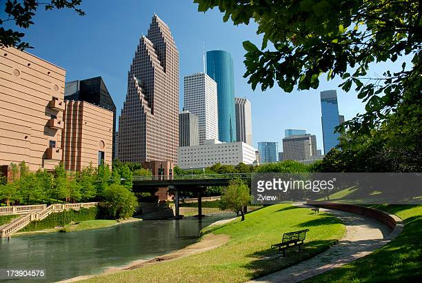 Modern skyscrapers in downtown Houston behind park with lake