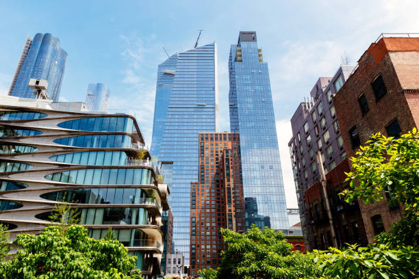 Modern skyscrapers of Hudson Yards and old residential buildings along High Line Park in New York, USA