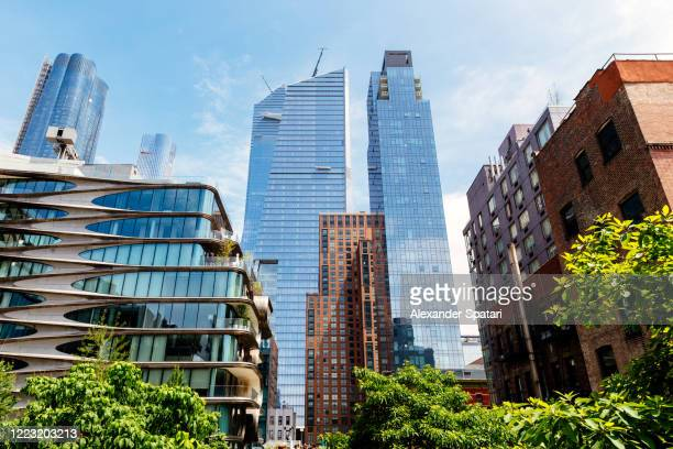 modern skyscrapers of hudson yards and old residential buildings along high line park in new york, usa - manhattan new york city stock pictures, royalty-free photos & images