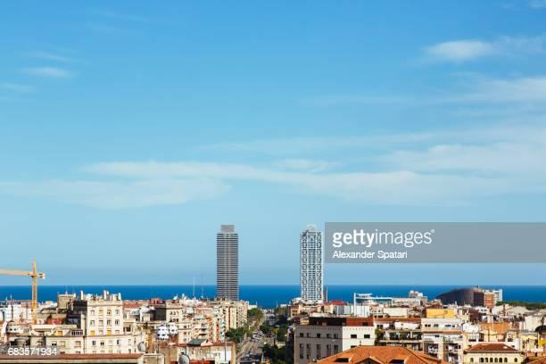 modern skyscrapers, old town and horizon over the sea in barcelona, catalonia, spain - la barceloneta stock-fotos und bilder