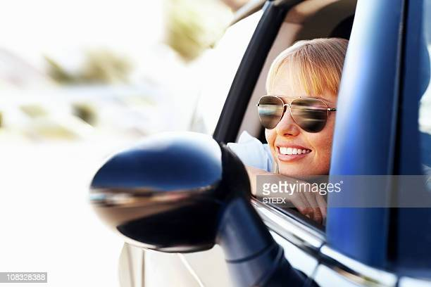 Modern smiling female enjoying a car ride