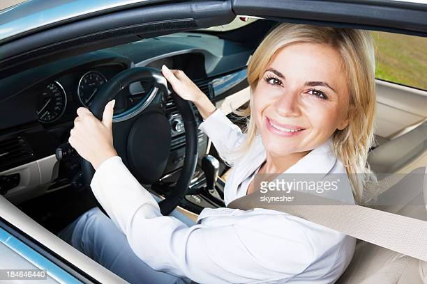 Modern smiling female enjoying in a car ride.