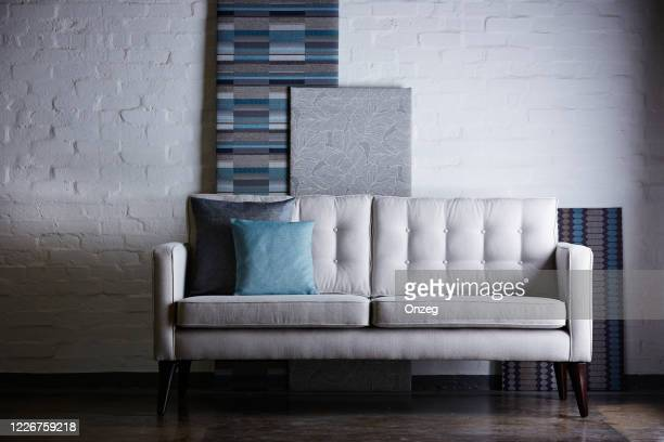 modern sofa against white brick wall - sun lounger stock pictures, royalty-free photos & images