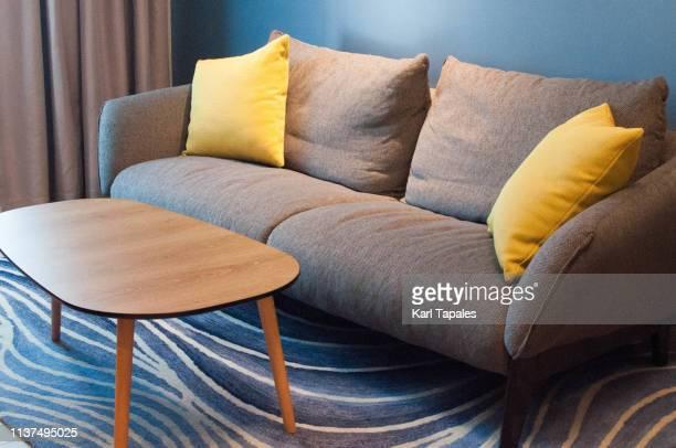 a modern sofa set - cojín fotografías e imágenes de stock