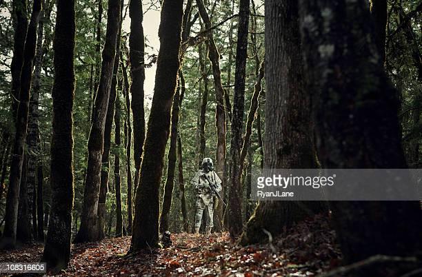 Modern Soldier in Dark Woods with Gun