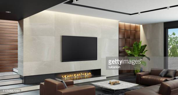 modern spacious minimalist living room with eco fireplace - geographical locations stock pictures, royalty-free photos & images