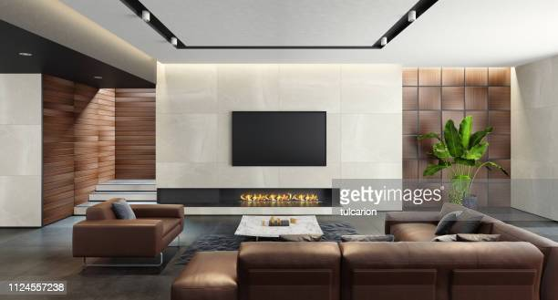modern spacious minimalist living room with eco fireplace - penthouse stock pictures, royalty-free photos & images