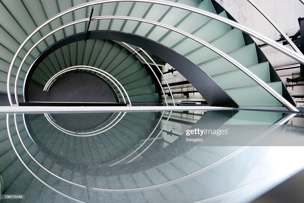 Modern spiral staircase with metal railing : Stock Photo