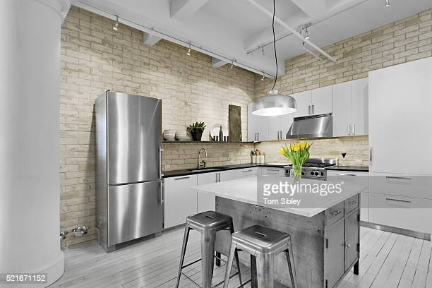 Modern stainless kitchen with ceramic brick