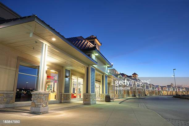 modern store building exteriors at sunset - consumentisme stockfoto's en -beelden
