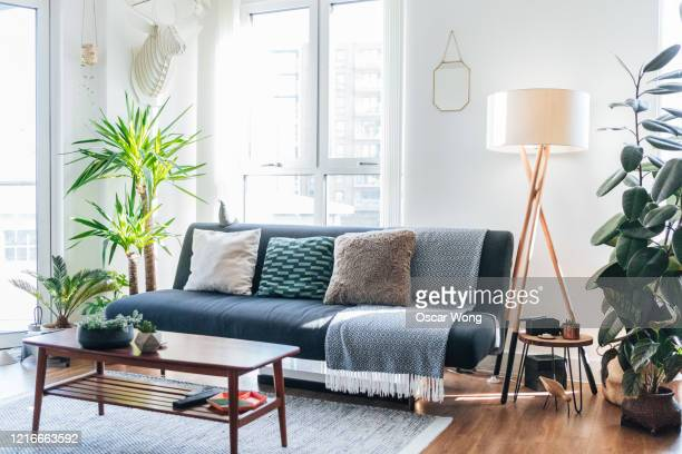 a modern, stylish and bright living room - salon fotografías e imágenes de stock