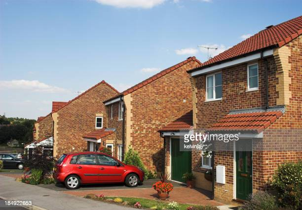 Modern suburban family houses with car on driveway