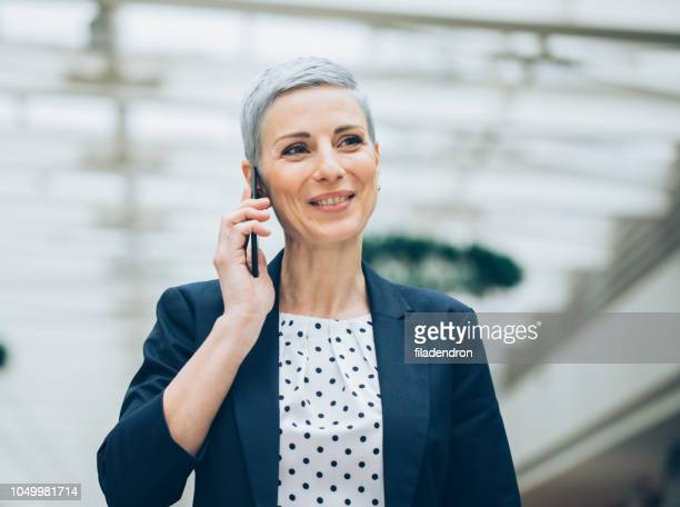 modern successful businesswoman - contact us stock pictures, royalty-free photos & images