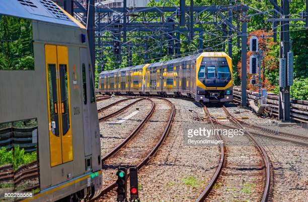modern sydney trains bi-level millenium services pass at central station - new south wales stock pictures, royalty-free photos & images