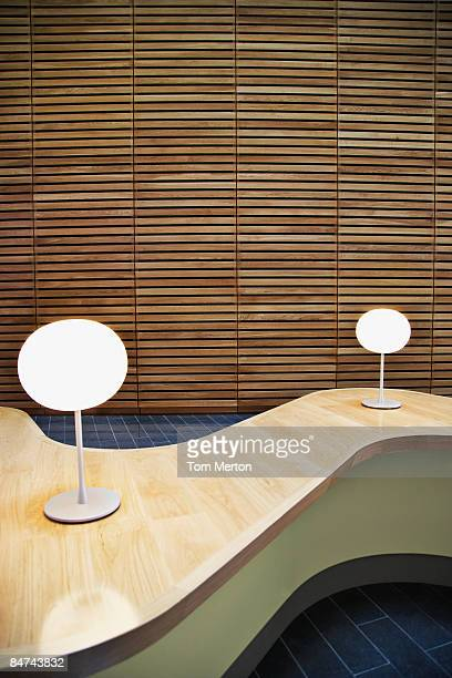modern table in office lobby - lamp stock photos and pictures