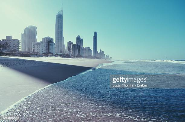 Modern Tall Buildings On Shore Against Clear Blue Sky