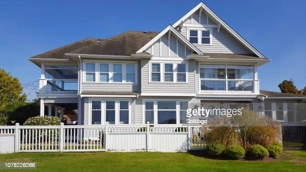 modern three story home with old fashioned sash windows - shunting yard stock photos and pictures