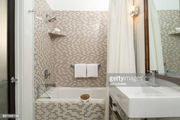modern tiled bathroom with shower and vanity - bathroom stock photos and pictures