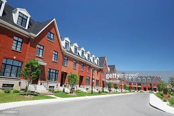 modern townhouses street - buzbuzzer stock pictures, royalty-free photos & images