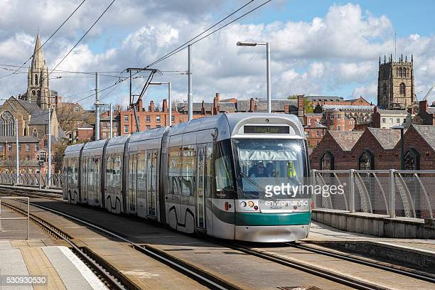 modern tram in nottingham city centre. - nottingham stock photos and pictures