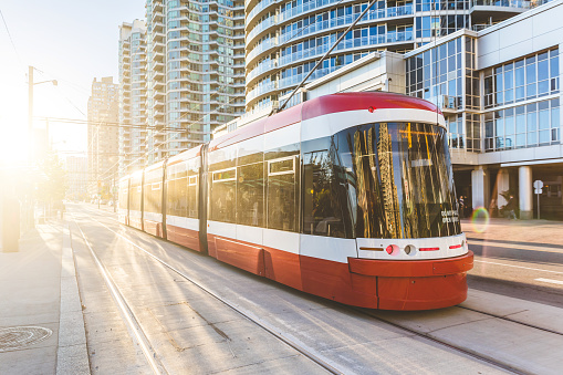 Modern tram in Toronto downtown at sunset 617357346