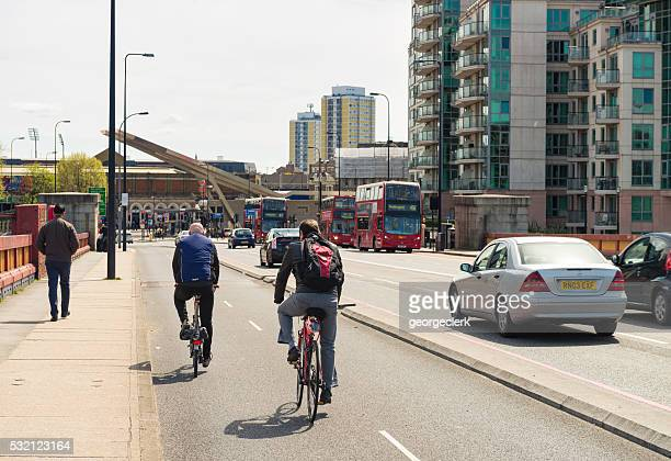 modern transport in central london - pedestrians stock photos and pictures