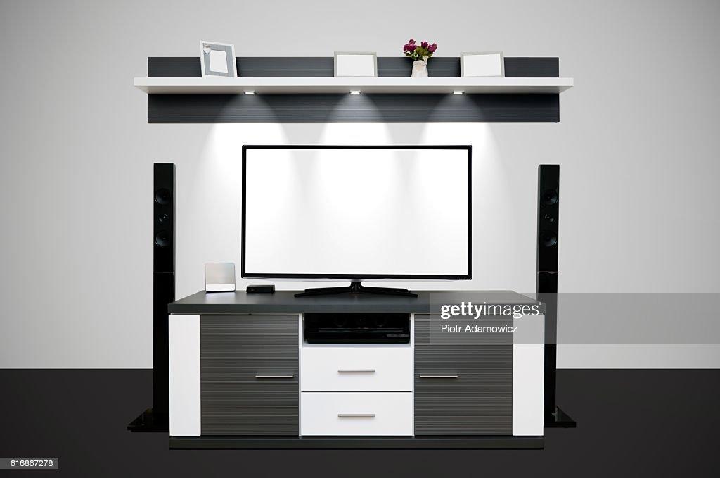 Modern TV room with illuminated LED lamps : Stock Photo