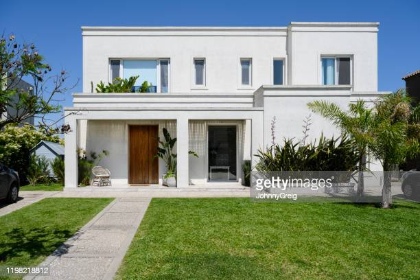 modern two-story home and front yard in buenos aires - facade stock pictures, royalty-free photos & images