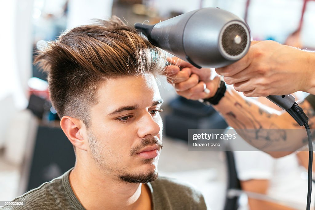 Modern Undercut Hairstyle For Young Man High-Res Stock Photo ...