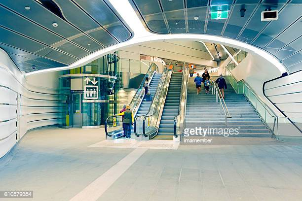 Modern underground subway with passengers and travellers Sydney Australia
