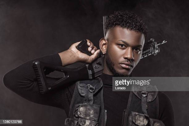 modern urban warfare military black male soldier in studio shoot - task force stock pictures, royalty-free photos & images