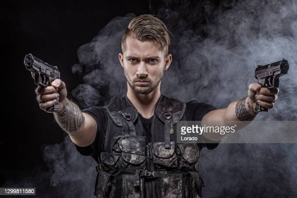 modern urban warfare military soldier in studio shoot - weaponry stock pictures, royalty-free photos & images