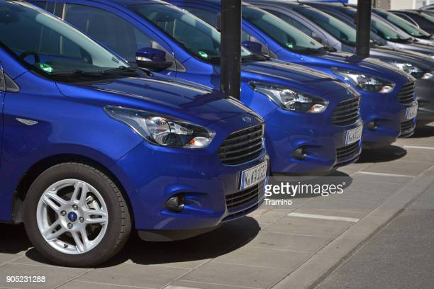 modern vehicles in a row - vehicle brand names stock photos and pictures