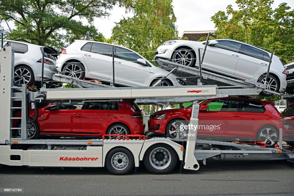 Modern Volkswagen Golf vehicles on the car transporter : Stock Photo