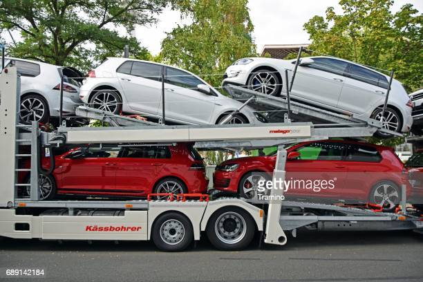 modern volkswagen golf vehicles on the car transporter - car transporter stock photos and pictures