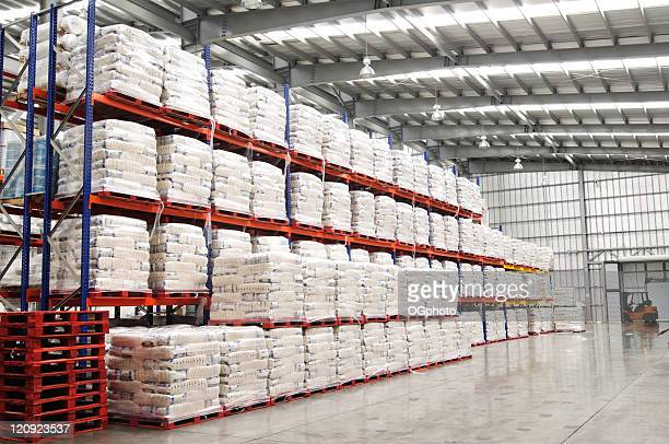 Modern warehouse with shelves full of stacked goods.
