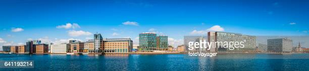 Modern waterfront cityscape panorama apartment buildings hotels offices Copenhagen Denmark