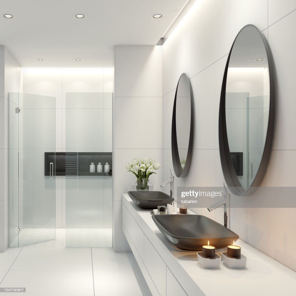 Modern White Bathroom With Oval Mirrors High Res Stock Photo Getty Images