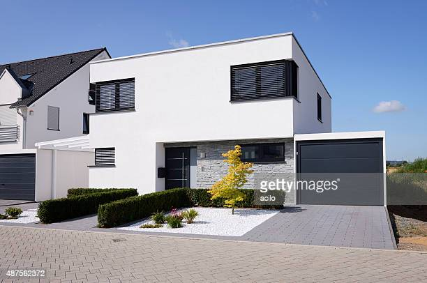 modern white house with garage - facade stock pictures, royalty-free photos & images