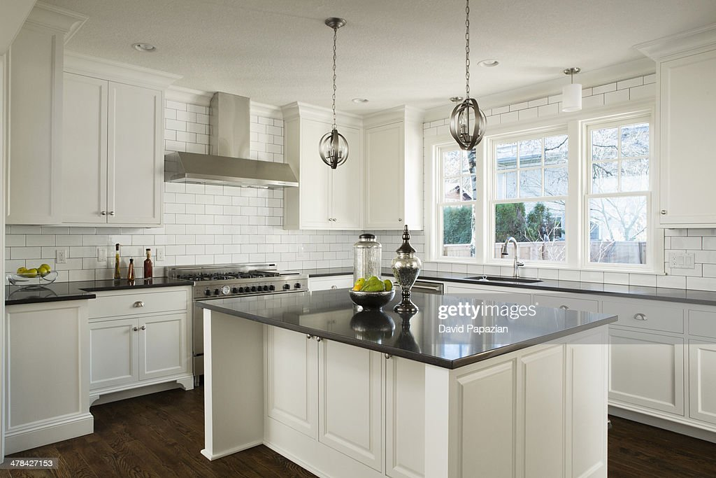 Modern white kitchen with lights off : Stock Photo