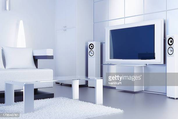 A modern white living room with a flat screen tv