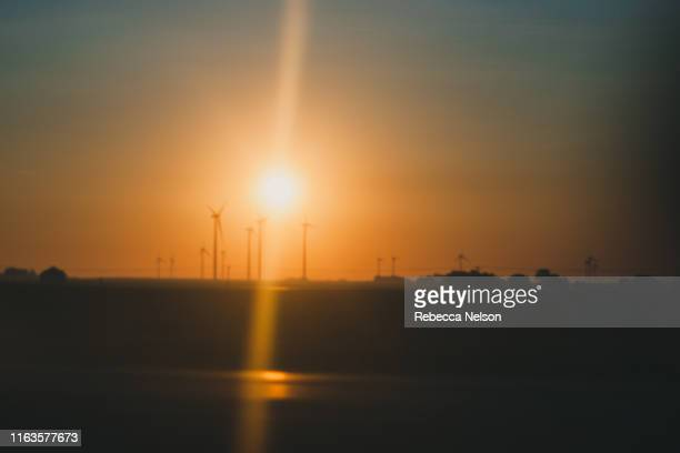 modern windmills at sunrise - rebecca nelson stock pictures, royalty-free photos & images
